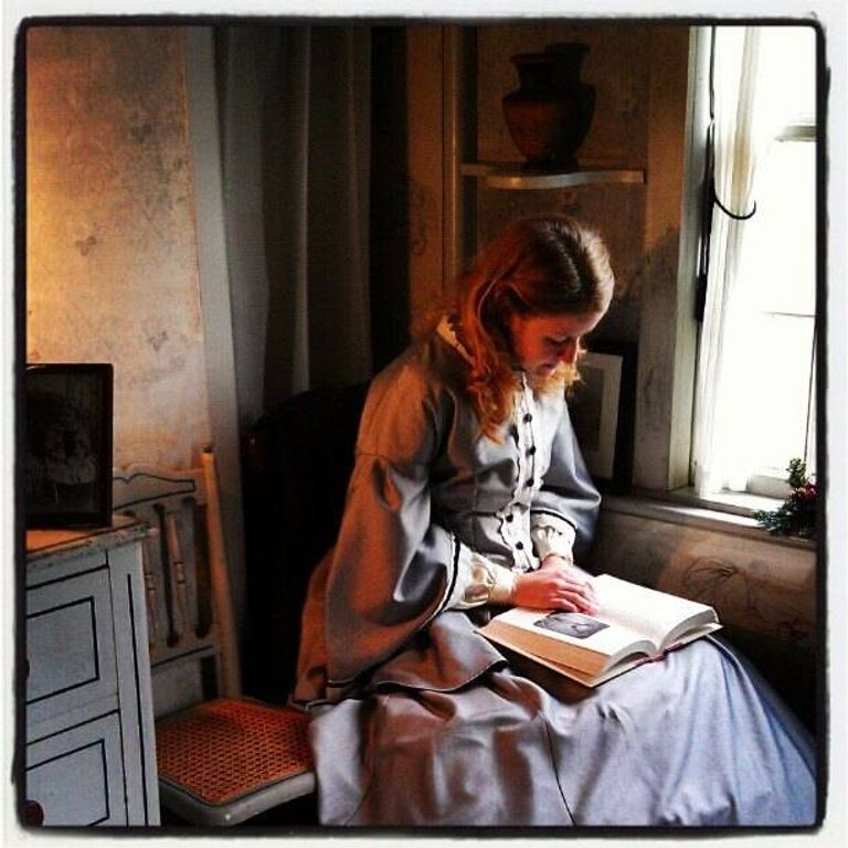 Jamie Lynne Burgess dressed as May Alcott at Louisa May Alcott's Orchard House Museum. Rewire PBS Little Women