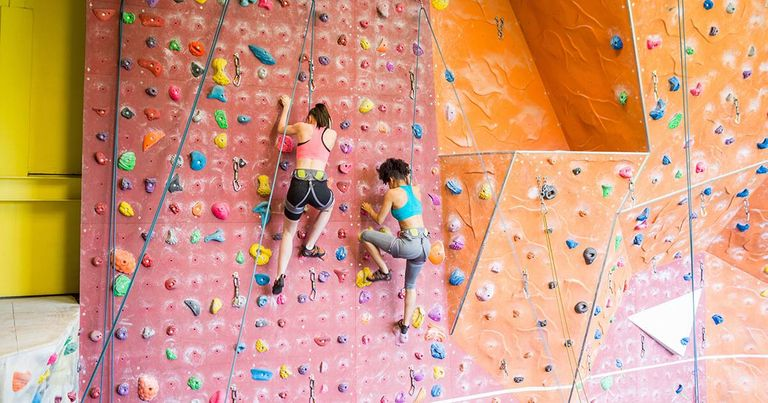 Fit women rock climbing indoors. Rewire PBS Living Healthy Habits
