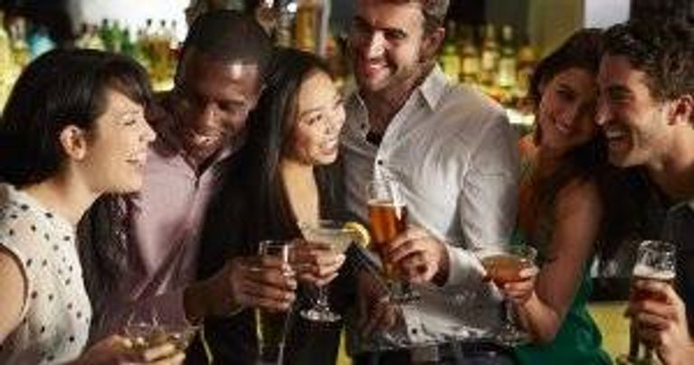 Group Of Friends Enjoying Drink In Bar. Plant-based diet pbs rewire