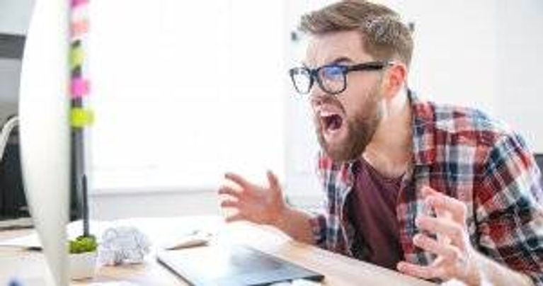 Bearded man screaming at his computer. Stop Stress pbs rewire