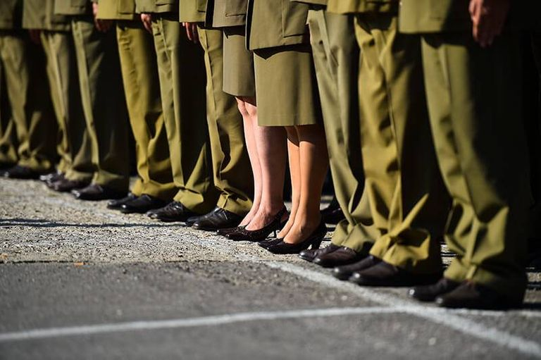 Male and female soldiers in uniforms standing in formation during military ceremony. Rewire PBS Our Future Draft