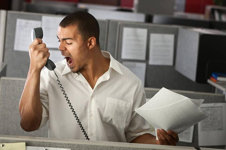 Angry Latino office worker yells on phone. Rewire PBS Our Future Positivity