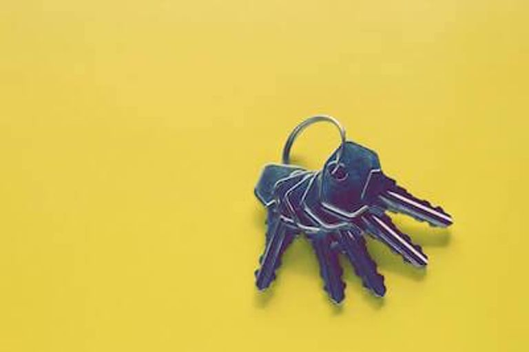 Set of keys on a yellow background. Moving Rewire PBS