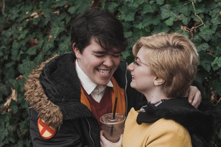 Young LGBTQ couple laughing together. Wedding Expectations pbs rewire