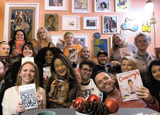 Photo of a group of people, holding books and smiling. Rewire PBS Living Book Club
