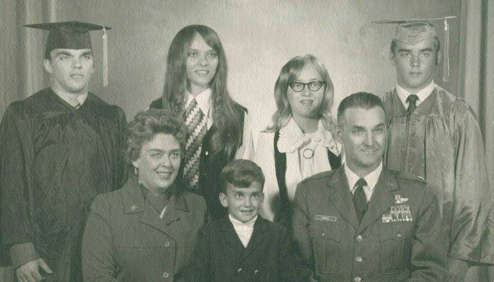 Photograph of family dressed formally and in military uniform