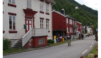 Red and white buildings alongside a road