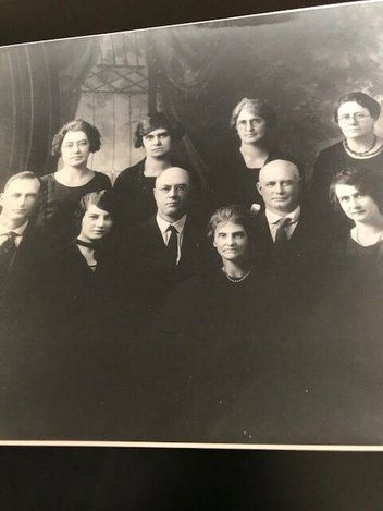 A portrait of the Boudreau family. Dennis Boudreau is in the middle row, third from the left.