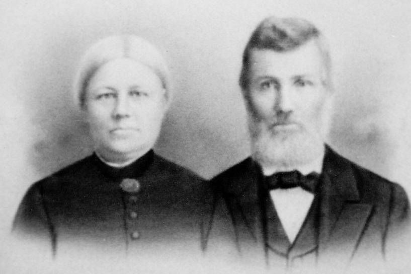 Photo of man and woman wearing black jackets