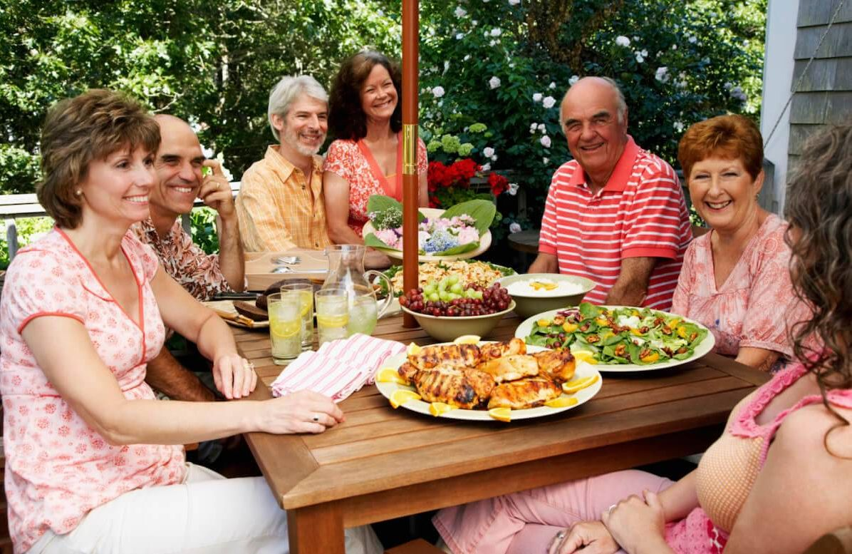 Family eating meal outdoors