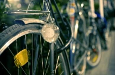 close up of light and reflectors on bicycle