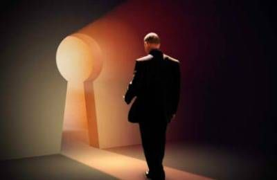 man walking thru keyhole-shaped doorway
