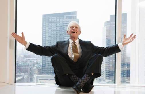Senior executive expressing joy from window seat