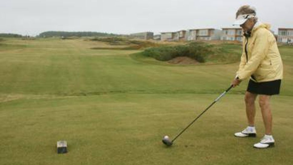 Mom teeing off at Cabot Links