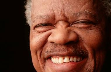 an older african american man with a big smile
