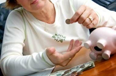 woman raiding piggy bank for money