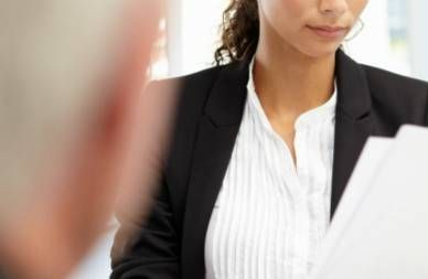 younger businesswoman interviewing older applicant