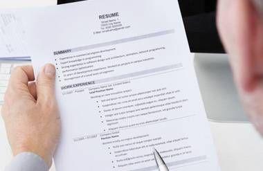 Man reading resume