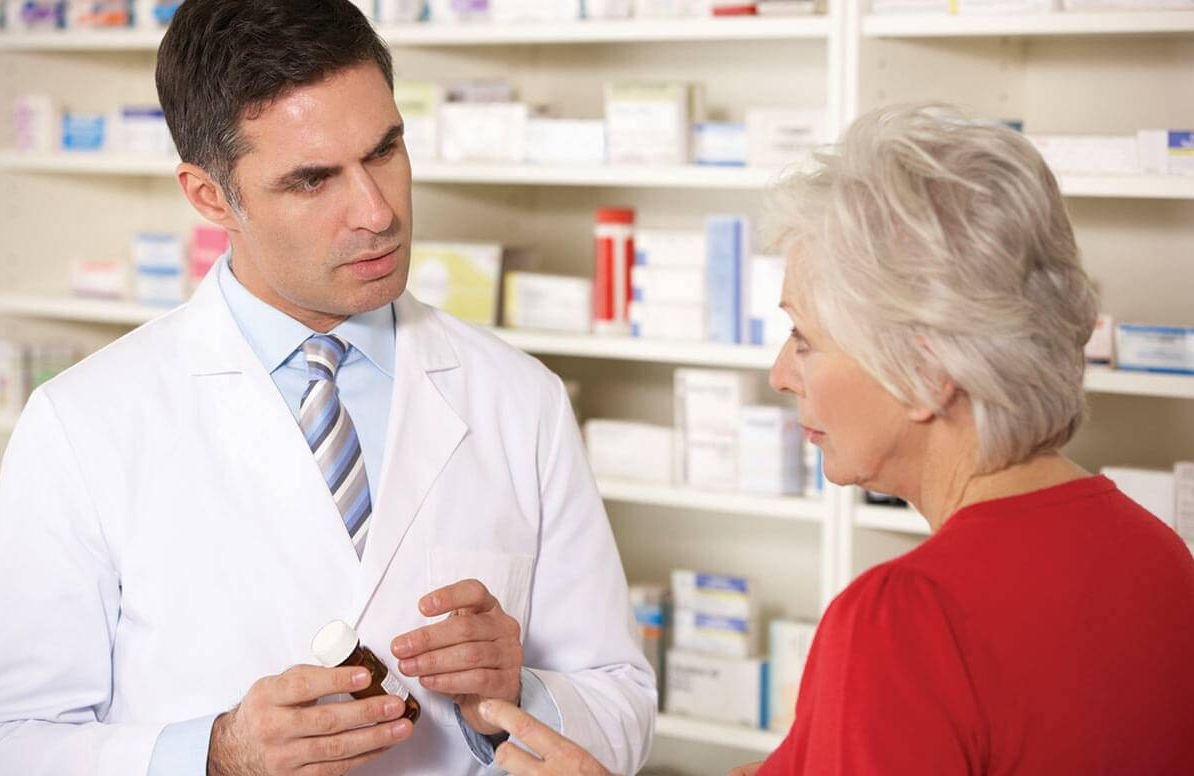 Woman consulting her pharmacist