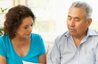 Couple reviewing financial document