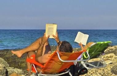 Couple reading on vacation