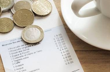 Euro coins on a receipt