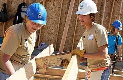 Habitat for Humanity volunteers Pam Nelson (L) and Kristina Owyoung