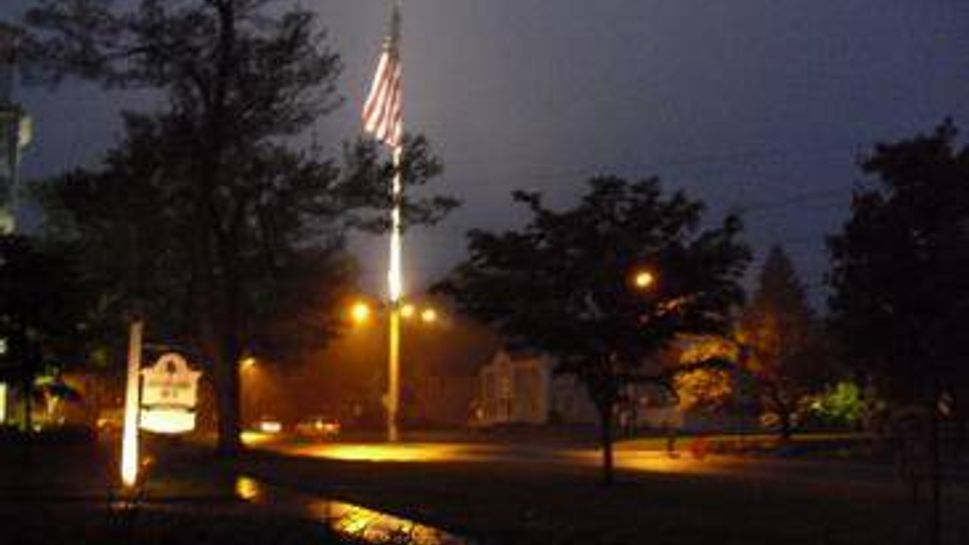 flagpole at night in newtown, ct