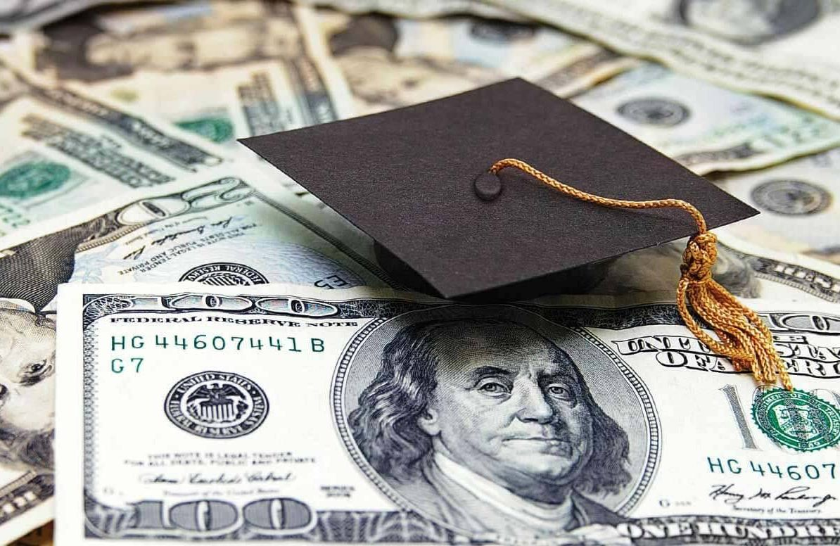 Illustration of money and graduation cap