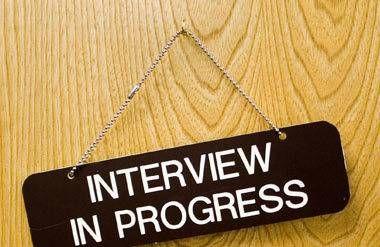 Interview in progress sign hanging on door