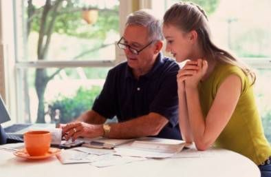 Father and daughter going over finances