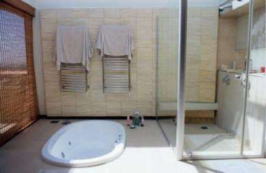 shower stall door even with floor and bathtub set into the floor