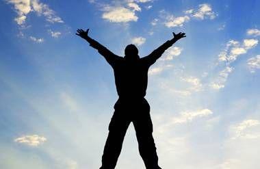 Silhouette of man feeling successful