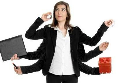 woman with 6 arms juggling laptop, phone, gift box