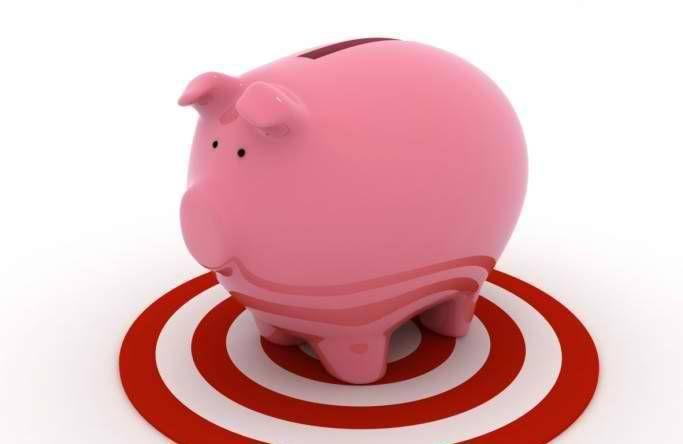 piggy bank on target symbol