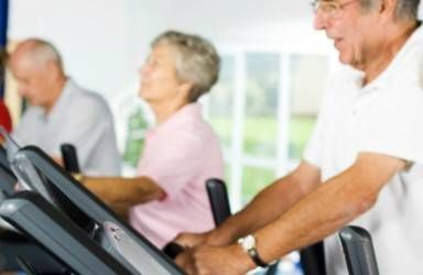row of seniors on treadmill at the gym