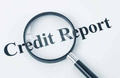 Magnifying glass over credit report