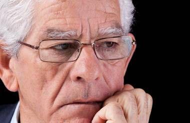 Sad older male worker