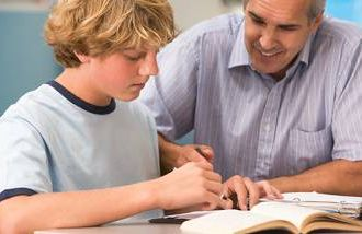 man tutoring young student