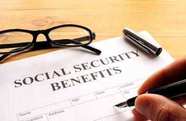 Person filling out Social Security Benefits form