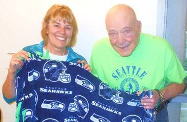 The writer and a retirement home resident make a blanket