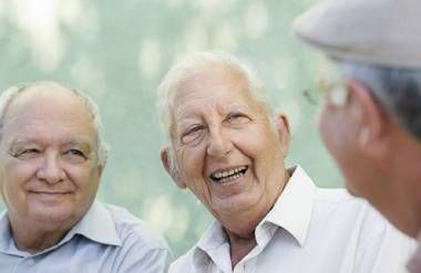 Group of older men laughing and talking