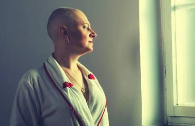 Cancer patient looking out window