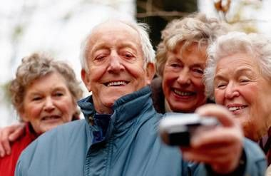 Man and three women taking a selfie