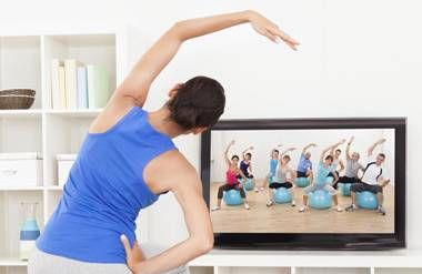Woman exercising to video at home