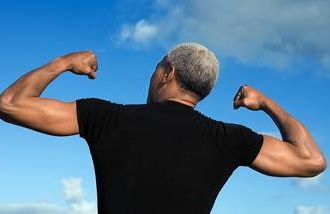 older african american man flexing his muscles