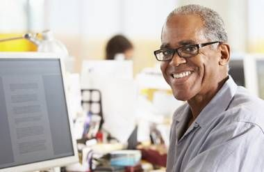 Older man working at computer at encore career