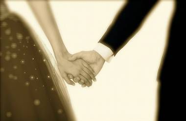 teenaged  boy and girl dress up holding hands