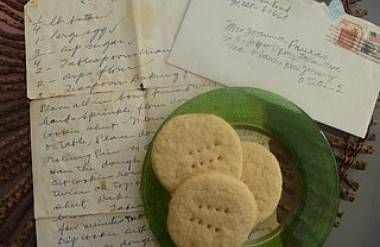 cookies on top of old letter with family recipe