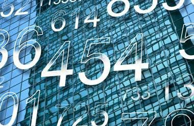 Numbers with building in background